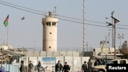 Afghan National Army soldiers and police keep watch outside the Bagram Airfield entrance gate. (file photo)