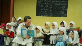 American writer Greg Mortenson with Gultori schoolchildren in Pakistan, undated.