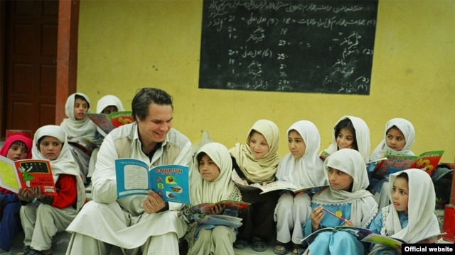 American writer Greg Mortenson with Gultori schoolchildren in Pakistan, undated.