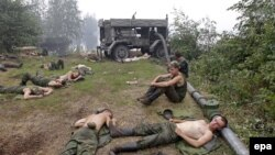 Servicemen taking part in fighting forest and peat fires rest in a forest near the town of Gus-Khrustalny in Russia's Vladimir region on August 2.