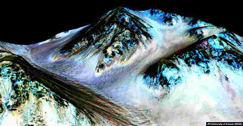 Dark, narrow, 100 meter-long streaks on Mars inferred to have been formed by contemporary flowing water are seen in an image produced by NASA, the Jet Propulsion Laboratory (JPL) and the University of Arizona. Scientists have found the first evidence that briny water may flow on the surface of Mars during the planet's summer months, on September 28, 2015. (NASA)