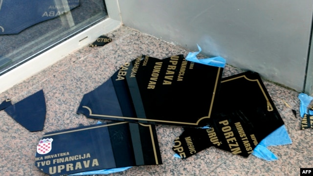 A sign with Serb Cyrillic script lies on the ground after being ripped off a wall by Croatian protesters in Vukovar on September 2.