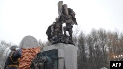 Russian Prime Minister Vladimir Putin takes part in a ceremony in Victory Park on Poklonnaya Hill in Moscow to unveil a replica of the Soviet World War II memorial destroyed in the Georgian city of Kutaisi in December 2009.
