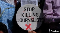 Fotografi nga një protestë kundër vrasjes së gazetarëve...