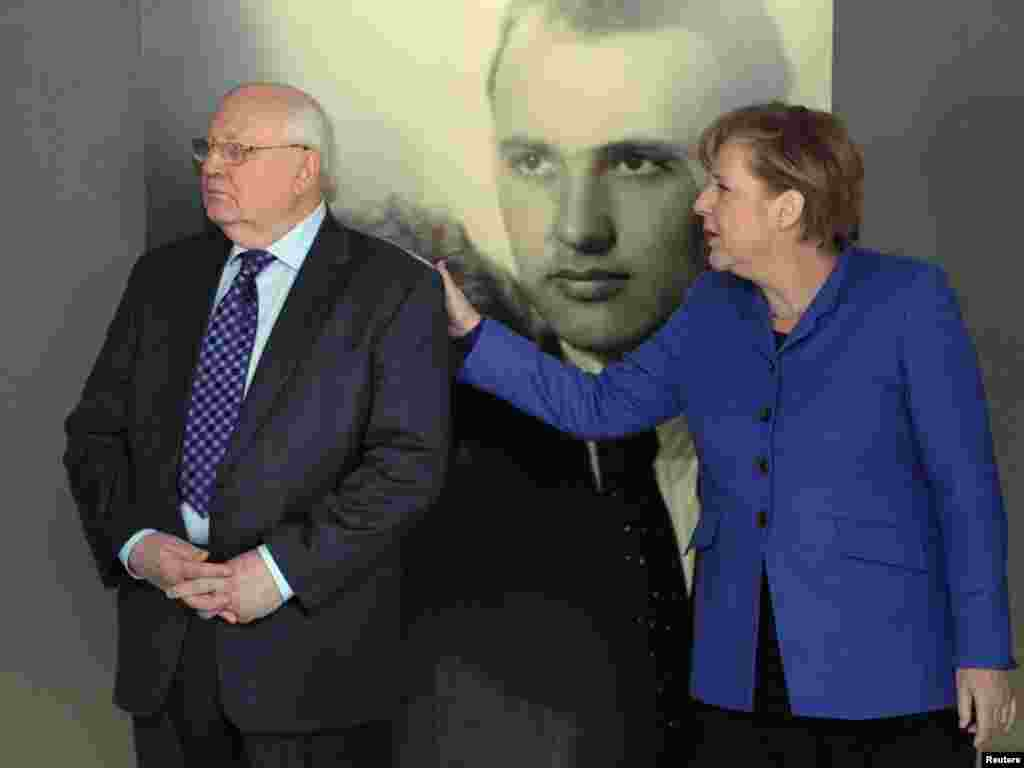 With German Chancellor Angela Merkel at an exhibition marking Gorbachev's 80th birthday at the Kennedy Museum in Berlin on February 24, 2011.