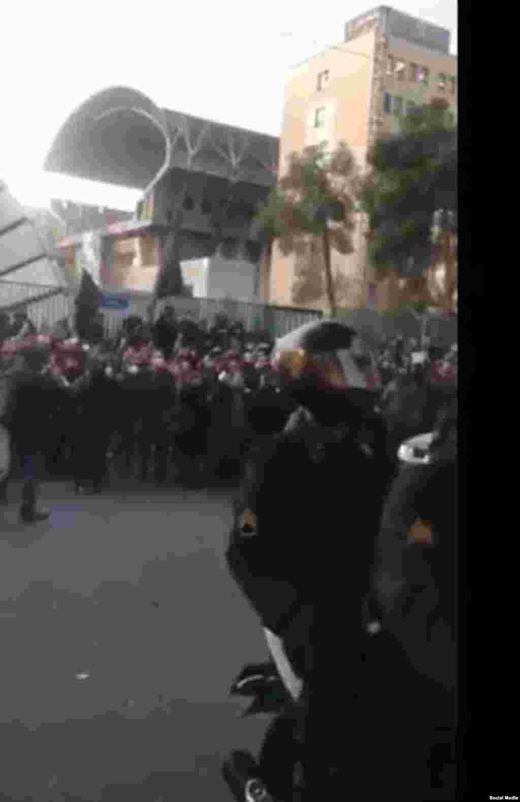 Riot police gather at Amir Kabir University in Tehran on January 11.