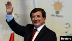 Turkey - Incoming Turkish prime minister Ahmet Davutoglu greets his supporters during the Extraordinary Congress of the ruling AK Party (AKP) to choose a new leader of the party in Ankara August 27, 2014