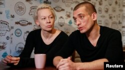Russian artist Pyotr Pavlensky (right) speaks while his partner Oksana Shalygina looks on during an interview with Reuters in Kyiv on January 4.