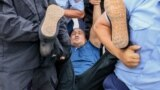 KAZAKHSTAN -- Police officers detain an opposition supporter in Almaty, June 10, 2019