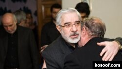 File photo: December 2009 Iranian opposition leader Mir Hossein Mousavi (C) meet with the mourning family of kill Seyyed Ali Habibi Mousavi Khamene, Tehran,