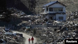 Japan - People walk at an area that was damaged by the March 11 earthquake and tsunami, in Miyako, Iwate prefecture, 05Apr2011
