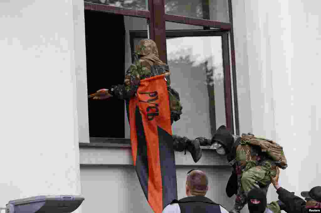 Pro-Russia activists attack a regional administration building in the eastern Ukrainian city of Luhansk on April 29. (Reuters/Vasily Fedosenko)