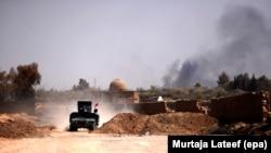Автомашина армии Ирака в населенном пункте близ иракского города Мосул. 23 августа 2017 года. Иллюстративное фото.