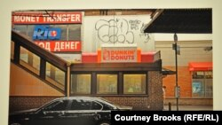 An exhibit photo of a doughnut shop in Brighton Beach, a Russian-speaking neighborhood in New York
