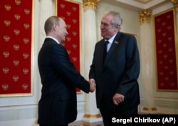 Russian President Vladimir Putin (left) welcomes Czech President Milos Zeman during a ceremony in the Kremlin prior to the Victory Parade marking the 70th anniversary of the defeat of the Nazis in World War II in May 2015.