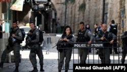 Israeli security forces stand guard at one of the entrances to Al Aqsa mosque compound in the Jerusalem's Old City on July 14, 2017