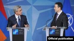 Belgium - NATO Secretary General Anders Fogh Rasmussen (R) and Armenian President Serzh Sarkisian address media after talks in Brussels, 6Mar2012.