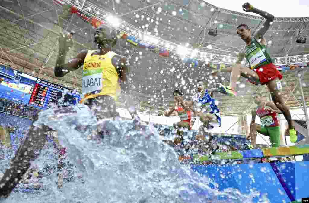 Athletes compete in the men's 3000-meter steeplechase event.