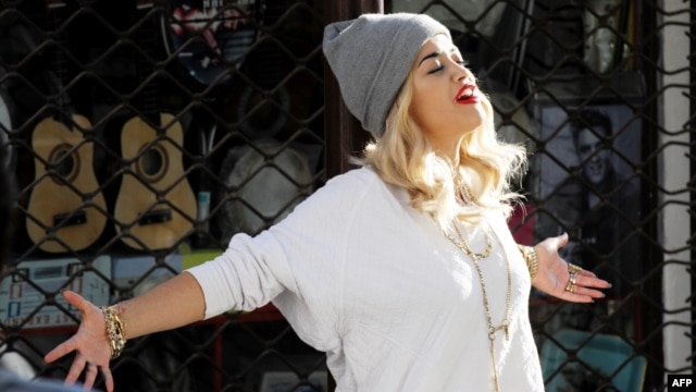British singer Rita Ora poses during the filming of her new music video in Pristina in September.