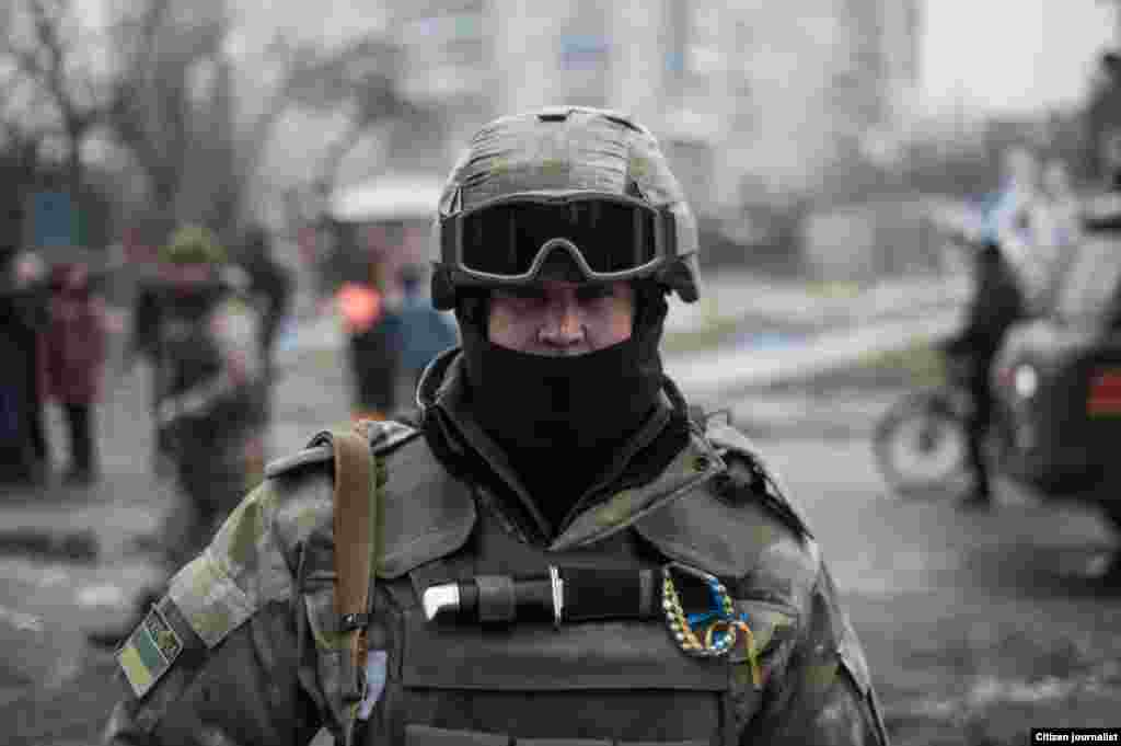 Debaltsevo township, Donetsk region, Ukrain. The territory is under ukranian control. The center of distribution of humanitarian aid in a former city hall. The ukrainian soldier.