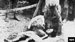 An Armenian woman mourns over the body of a boy in Konya Province during the World War I-era deportations of Armenians.