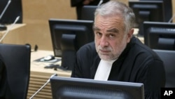 International Criminal Court prosecutor Luis Moreno-Ocampo in a courtroom in The Hague