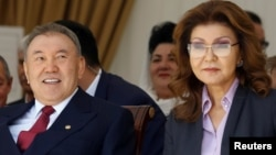 Former Kazakh President Nursultan Nazarbaev (left) and his daughter Darigha, who is now chairwoman of the country's Senate.