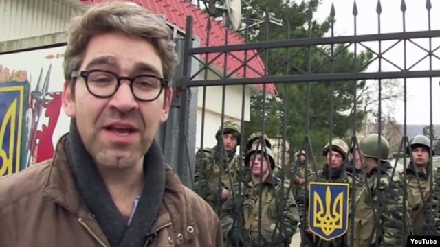 A video grab showing Vice New journalist Simon Ostrovsky reporting from Ukraine.