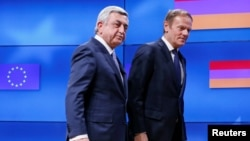 Belgium - Armenia's President Serzh Sarkisian (L) walks next to European Council President Donald Tusk after a joint news statement in Brussels, Belgium February 27, 2017