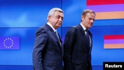 Belgium - Armenia's President Serzh Sargsyan (L) walks next to European Council President Donald Tusk after a joint news statement in Brussels, Belgium February 27, 2017