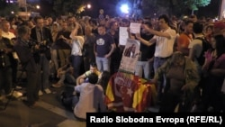 "Students gather to protest against police brutality in Skopje on May 8. Leaked wiretaps suggesting rampant abuse of office have led some to suspect the Kumanovo incident was ""too suspicious."""