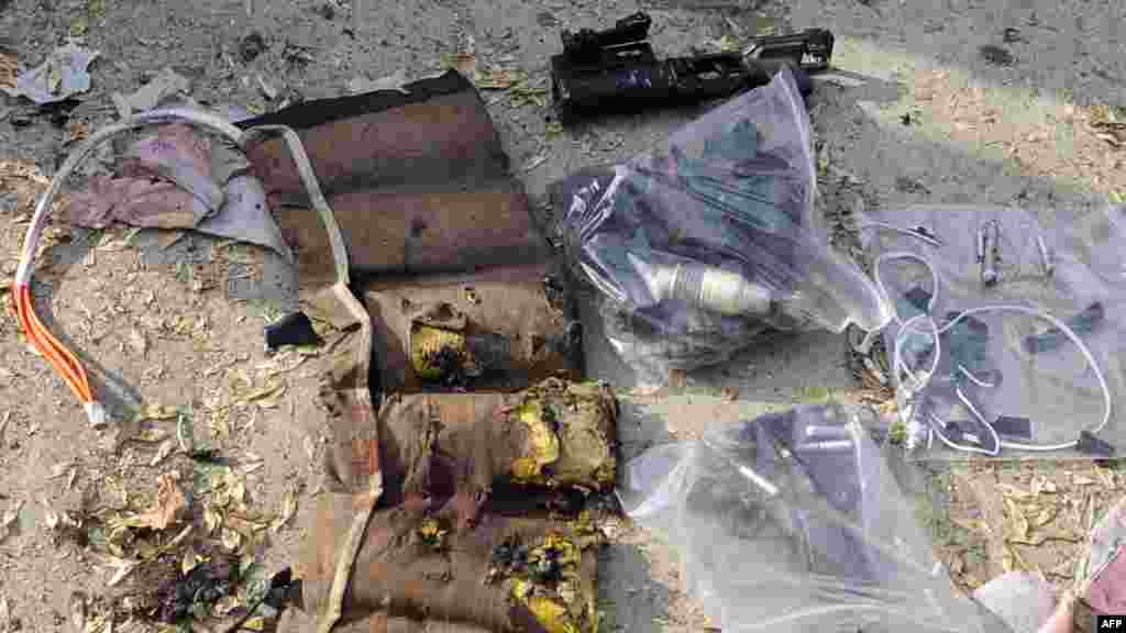 Weapons found at the scene include a grenade launcher, a gun, and part of the exploded vest of the suicide attacker.