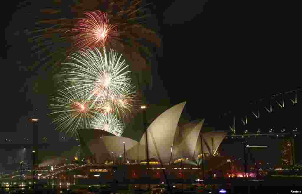 Fireworks explode over the Sydney Opera House as part of celebrations in Australia's largest city to usher in the new year on December 31. (Reuters/Jason Reed)