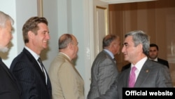 Armenian President Serzh Sarkisian (right) greets U.S. Deputy Assistant Secretary of State Matthew Bryza in Yerevan.