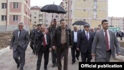 Armenia - Prime Minister Tigran Sarkisian (C) inspects apartment blocks constructed in Gyumri, 26May2012.