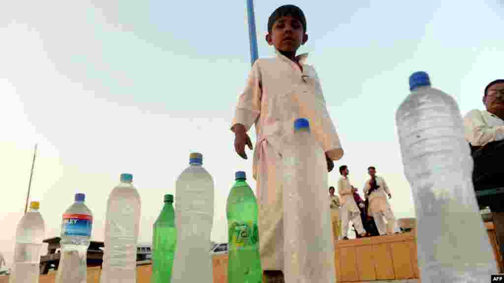 A child sells water on a beach in Karachi, Pakistan.