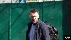 Opposition leader and anticorruption blogger Aleksei Navalny leaves a detention center in Moscow on March 6.