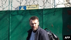 Opposition leader Aleksei Navalny leaves a detention center in Moscow.