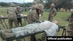 Armenia - Armenian army medics take part in a U.S.-led exercise at the Hohenfels Training Area, 19Apr2016.