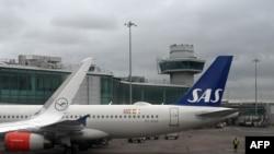 Самолет на SAS на летището в Манчестър (илюстративна снимка).