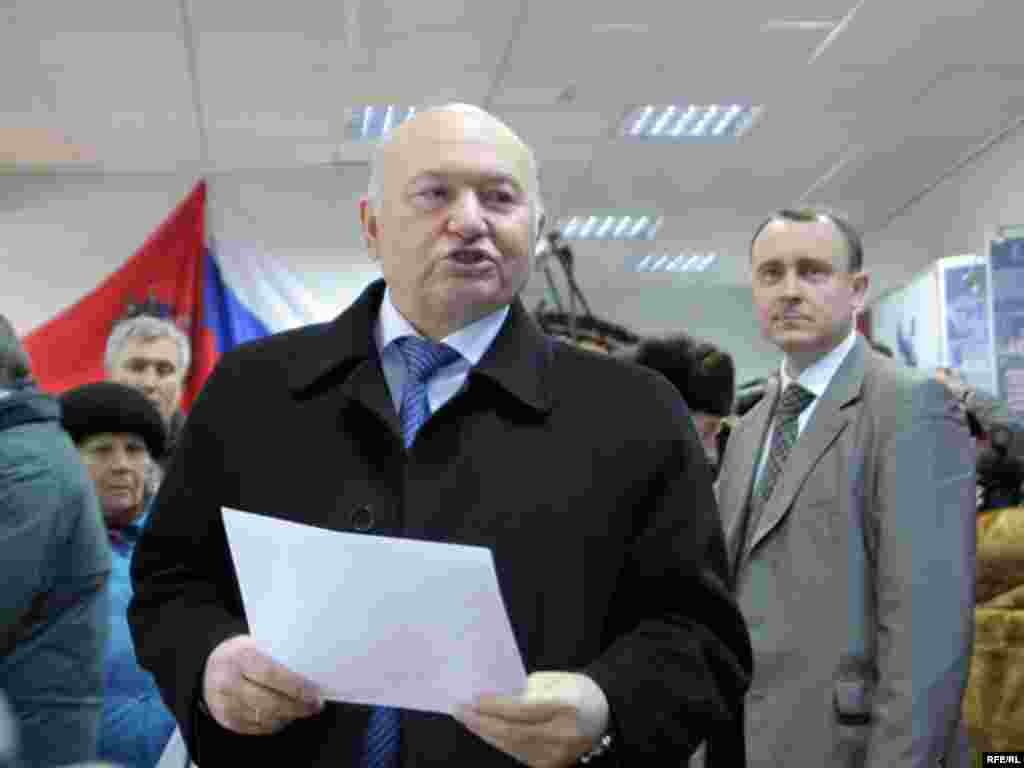 The mayor of Moscow, Yury Luzhkov, casts his ballot. Luzhkov is one of the founders of the pro-Kremlin Unified Russia party.