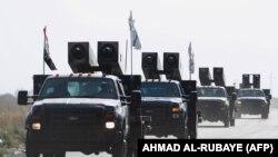 Iraqi forces drive towards Kurdish peshmerga positions on October 14, 2017, on the southern outskirts of Kirkuk.
