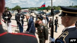 U.S. Secretary of Defense Chuck Hagel (left) and Azerbaijani Defense Minister Colonel General Safar Abiyev walk to the Pentagon during an honor cordon in Washington on August 5.