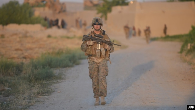 A U.S. Marine patrols in Afghanistan's southern Helmand Province. U.S. officials have said a residual U.S. presence after 2014 could range from a few thousand to 20,000 troops.