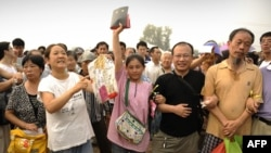 Supporters wait outside the trial of Chinese human rights activist Wang Lihong in Beijing in August.