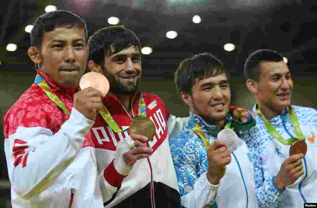 The victory ceremony for the men's 60-kilogram judo competition (left to right:) Naohisa Takato of Japan, Beslan Mudranov of Russia, Yeldos Smetov of Kazakhstan and Uzbekistan's Diyorbek Urozboev.