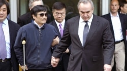 Blind activist Chen Guangcheng being accompanied by U.S. Assistant Secretary of State for East Asian and Pacific Affairs Kurt Campbell (right) and U.S. Ambassador to China Gary Locke (center) in Beijing on May 2.