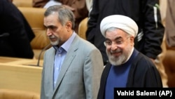 Iranian President Hassan Rohani (right) and his brother Hossein Fereidoun (file photo)