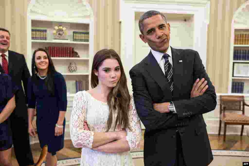 "U.S. President Barack Obama jokingly mimicks the ""not impressed"" look of U.S. Olympic gymnast McKayla Maroney (left) while greeting members of the 2012 U.S. Olympic gymnastics teams in the Oval Office. (AFP/White House Photo/Pete Souza)"