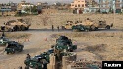 Афганські сили безпеки під час перестрілки в місті Кундуз, 29 вересня 2015 року